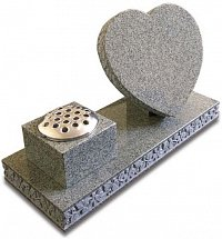 Karin Grey granite heart and vase memorial with floral carved edges.