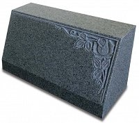 An upright Karin Grey granite tablet memorial with deep carved rose design.