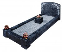 A Bahama Blue granite kerb set memorial with a rose design.