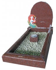 An Indian Ruby Red granite childs memorial, with a coloured ornament.